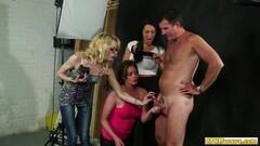 Naughty Photographer babes gives group handjob Thumb