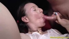 Brunette stuffs her mouth with cock Thumb