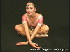 Two ballerinas shows flexible excersises Thumb