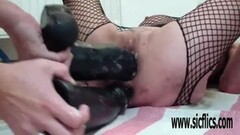 Huge double dildo fucking each of her wrecked holes Thumb